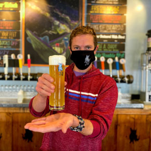 Picture of beertender holding a beer