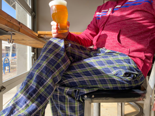 Person drinking beer in pajama pants