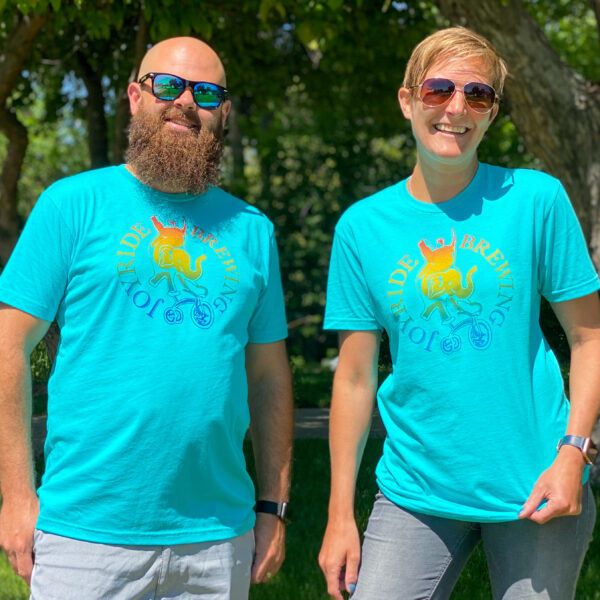 Two people wear Pride shirts